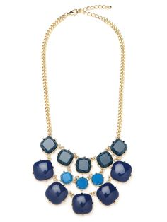 Lose yourself in the hypnotic ocean blues of this stunning statement necklace. It features three glorious tiers of gemstones, each bigger and bolder than the next.
