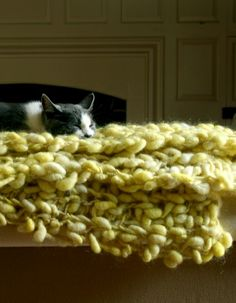 Beautiful knitted afghan from thick handspun yellow green wool, with cat
