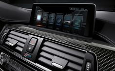 Control Display in the BMW M3 Sedan with Carbon Fiber interior trim
