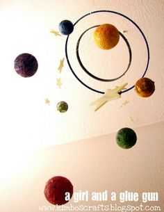 Solar system mobile from painted embroidery hoops and styrofoam balls.