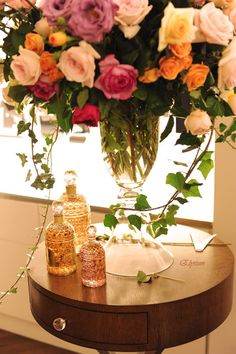 Guerlain bottles and floral arrangement... want this for bathroom!