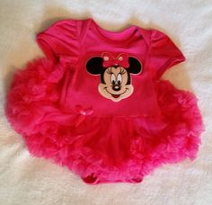 This is a cute dark pink Minnie Mouse Onsie with ruffles and it comes with the headband of your choice. You pick one.  You can also decide to get matching socks with it ...just click on the one with the socks.