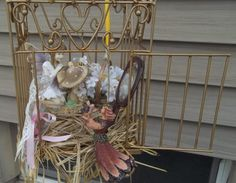 fairy garden in a thrift store bird cage
