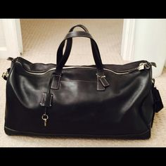 Shop Women's Coach Black Silver size 22x15x9 Travel Bags at a discounted price at Poshmark. Description: Genuine Coach leather duffel/weekender bag. Handles, and detachable strap. Keys are attached with leather fob. I keep my things in great shape, but as it is a travel bag I cannot say that of the airlines. Scuffs are shown close up(although very light) and the feet on button are attached, but some of the bumper around two of them is worn down. Edges of one bottom corner also shown ... Coach Duffle Bag, Coach Bags, Gym Bags, Travel Bags, Black Silver, Black Leather, Shape, Button, Fashion Trends