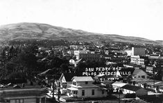 (ca. 1940)^* – View of San Pedro with the Palos Verdes Hills in the background.  The large building at center-right is the Warner Grand Theatre.