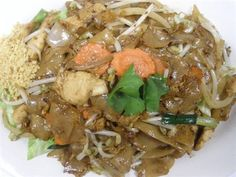 Chicken Noodles :Rice noodles stir-fried with chicken, egg, bean sprouts, onion, carrot, and ground peanuts; served with lettuce. #chicken #Noodles #meat #vegetables #Awesome Thai #Food forked.com