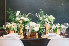 Copper vases and white flower arrangements