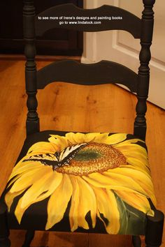 Irene painted the chair with #CottagePaint Black and then decorated the seat in acrylics.