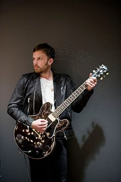 Caleb Followill (b. January 14, 1982, lead vocals, rhythm guitar) of Kings of Leon. The band is composed of brothers Caleb Followill, Nathan Followill (b. June 26, 1979, drums, percussion, backing vocals) and Jared Followill (b. November 20, 1986, bass guitar, backing vocals), with their cousin Matthew Followill (b. September 10, 1984, lead guitar, backing vocals).