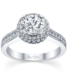 Double halo engagement ring with round center diamond from DeBebians.