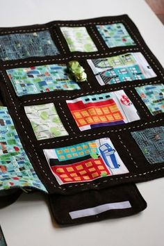 Roll up road play mat. As an ill mom, these are the kinds of things to keep your eye out for... fits in a purse, great for waiting rooms, quiet, a new game every time, bring a few cars and other kids can join.