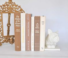 6 TAN / BROWN and WHITE Vintage Decorative Books for Home Decor / Wedding Decor / Modern Chic / BookShelf Decor. $29.50, via Etsy.