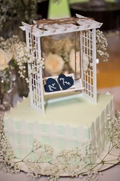 Picket Fence Wedding Cake with Trellis Swing and Hearts