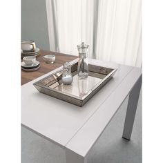 This decorative and functional Elvira tray is constructed of MDF with polished edges for a smooth finish. A unique glass mirror lays within the bottom of tray.