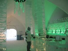 Quebec Ice Hotel - bar with green lighting. Your drink will always be cold. lol