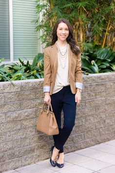 Five go-to tops to make you look effortlessly put together | tops to look instantly put together | polished outfits | easy casual outfit | easy office outfit | date night | gibson twist front | zella twist front | M. Gemi cerchio sneaker review | whbm jacket | blanknyc faux leather jacket | lush tunic blouse | madewell v-neck tee | lace tee top | J. Crew Factory drapey tee camel blazer