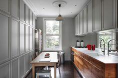 Hammersmith Grove by MWAI.   Grey painted modern traditional kitchen. Corian surface and sink with mirror splashback.   #kitchen #interiors #london #english #oak #corian #panelling