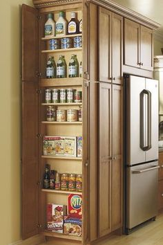 what about adding this w/door to one or both end kitchen cabinets This Utility Cabinet's adjustable shelves make storing all of your pantry items easy and give you the space you need. By Thomasville Cabinetry. Diy Kitchen Storage, Kitchen Redo, Kitchen Organization, New Kitchen, Kitchen Ideas, Hidden Kitchen, Organization Ideas, Awesome Kitchen, Organizing