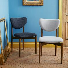 These were the most comfortable dining chairs at any store!  http://www.westelm.com/products/dane-dining-chair-h1035/?pkey=cdining-chairs