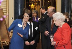 Dr Claire Breay of the British Library talks The Queen and the Duke of Edinburgh through through the details of the Magna Carta during the reception at Buckingham Palace. 23 February 2015/