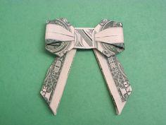 origami bow with a dollar bill Dollar Oragami, Oragami Money, Dollar Bill Origami, Money Lei, Dollar Bills, Gift Money, Fold Dollar Bill, Money Gifting, Money Rose