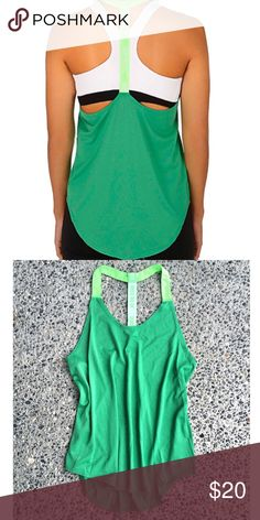 Elastika Nike Tank Perfect for training in the gym and layering over your favorite bright sports bra, 81% polyester, 19% spandex, loose fitting, machine wash cold.  NWOT. Nike Tops Tank Tops