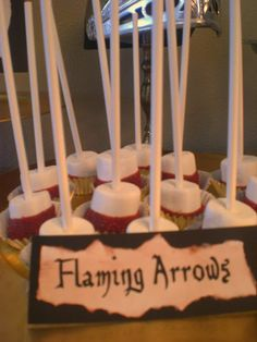Flaming Arrow snack...marshmallow on a stick -dipped in chocolate with red sprinkles.