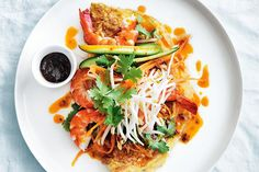 Spicy omelettes with asian prawn salad. Photographed by William Meppem