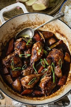 Filipino Chicken Adobo is a rich soy sauce and vinegar based chicken stew with carrots and potatoes.