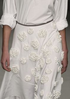 Skirt with beaded applique circles - white on white embellished fashion details // Prada