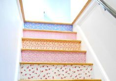 s 15 bold ways to redo your outdated staircase without remodeling, home improvement, stairs, Stick strips of fun fabric over the risers