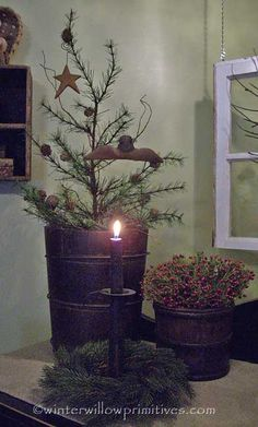 Prim Wooden Bucket...twiggy pine with stars, bells, & angel...lighted candle...Christmas.