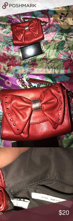 Nine West mini shoulder bag Red bow with studs . Chain straps in good condition not tarnished. In good condition super cute. Nine West Bags Crossbody Bags