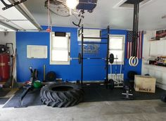 Simple, clean, and well-equipped garage gym with yet another giant tractor tire