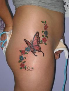 Hot red butterfly tattoo on hips