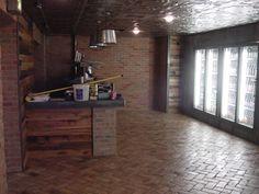 Hop Shop Beer Market. Inside. Masonry Brick by: Village Craft Iron & Stone, Inc.