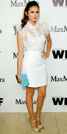 Dobrev arrived at a Max Mara cocktail party in a white ensemble that she styled with a turquoise clutch and shimmering sandals.
