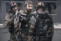 Kruger and his buddies from Elysium. As a group, they look badass. That white goat stencil is similar to the MNU mercenary symbol from District 9.