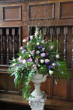 The pedestal designs of tall towering willow with larkspur, Hydrangeas, September Flower, Lissianthus, Roses, Palms, Ivy, Eucalyptus and Sperenegrii