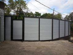 Fence Masters DFW - Replace old wood fence with 9ft high Corrugated metal fence with custom wood designs.