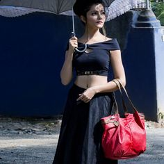Wearing an all-black ensemble can be boring, not when you have a gorgeous red #totebag to hold in your hand. #Baggit