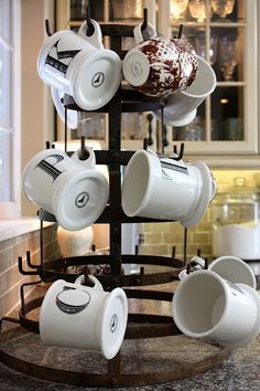 love the look of coffee mugs on this metal tree!