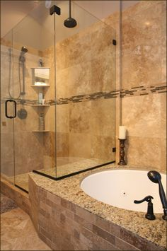 travertine shower tile.... Looks a lot like Ginny's bathroom style/colors ... I likes!!!