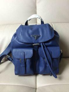 ad63a9890738 Prada BZ6677 Mini Junior Signature Vela Leather Backpack Blue -  pradafire.com