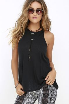 Get your gladiator sandals on, because you and the RVCA Label High Neck Tunic Black Tank Top have a date with the beach! Lightweight burnout knit travels from a high, rounded neckline into a relaxed, sleeveless bodice with tunic length. Logo tag at side.