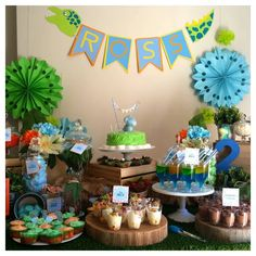 Dinosaur dessert and candy buffet with blue, orange and green theme