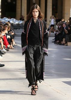 A change of venue saw Isabel Marant's spring-summer 2016 runway show take place in an outdoor setting, the Jardin du Palais-Royal. The change of location worked well with Marant's street style, Parisian cool looks which fused tribal inspired details with a modern, urban silhouette. From hot pants in glittering sequins to cropped jackets and knit …
