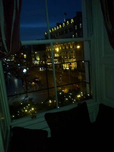 A view of the Shelbourne Hotel at dusk from a pre-Christmas lunch in Restaurant Forty One at dusk. Office Water Cooler, Shelbourne Hotel, Cafe Seating, Christmas Lunch, Wonderful Places, Dusk, Dublin, Bar Stools, Literature