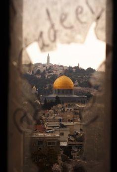 Looking at Qubah Al Sakhra through a shattered window.  Al Quds, Palestine  palisplace93