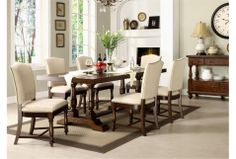 The Arlo dining set with cream upholstered seats and dark wood.